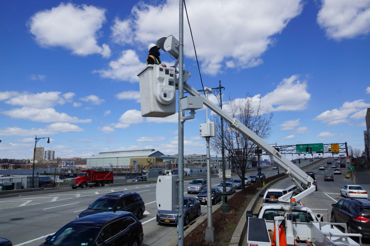 Man in bucket truck installing a camera