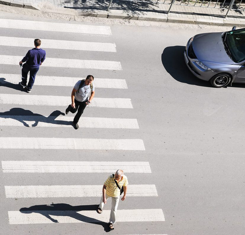 people crossing a crosswalk